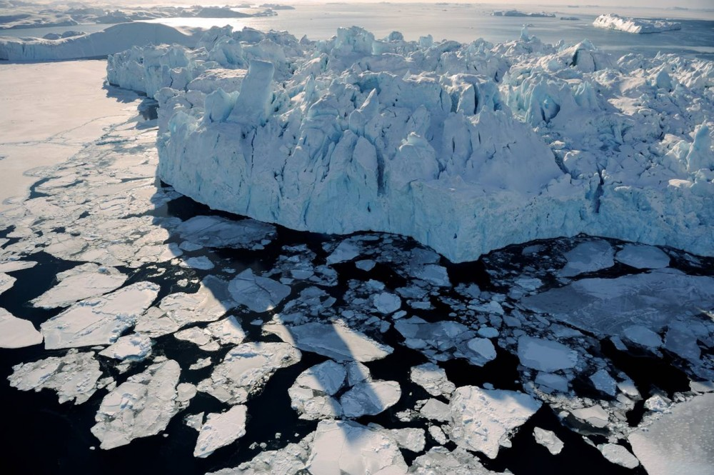 James Balog, Bay, Greenland, 15 March 2008. A massive chunk of the Ilulissat Glacier floats out to sea. Photograph Copyright 2014 James Balog/Extreme Ice Survey Courtesy of the artist